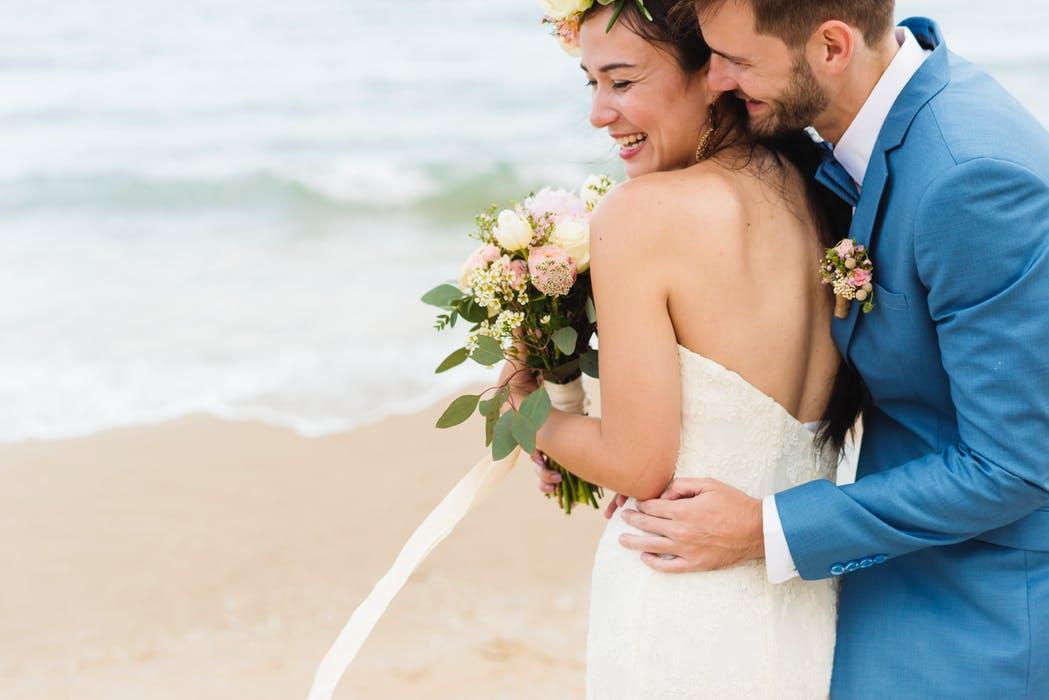 couple posing in a beach for their prenup photos